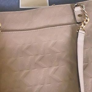 Beige shiny patent leather bag.
